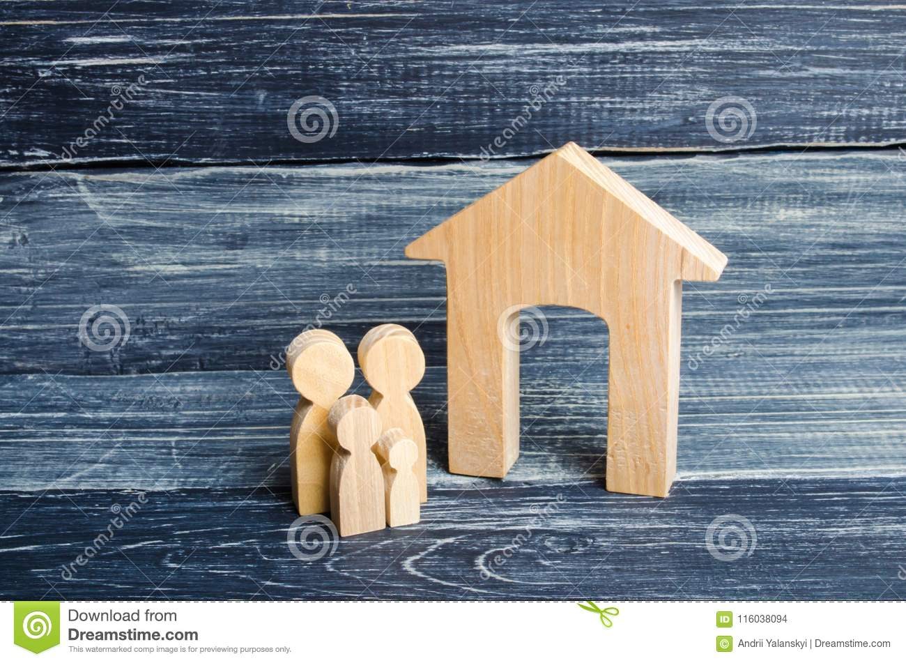 Young parents and a child are standing near their home. Concept of real estate, buying and selling a house. Affordable housing