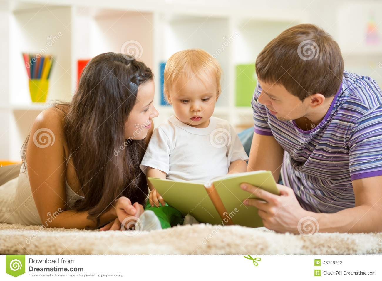 Young Parents Mom And Dad Reading Children Book To Stock Photo ...