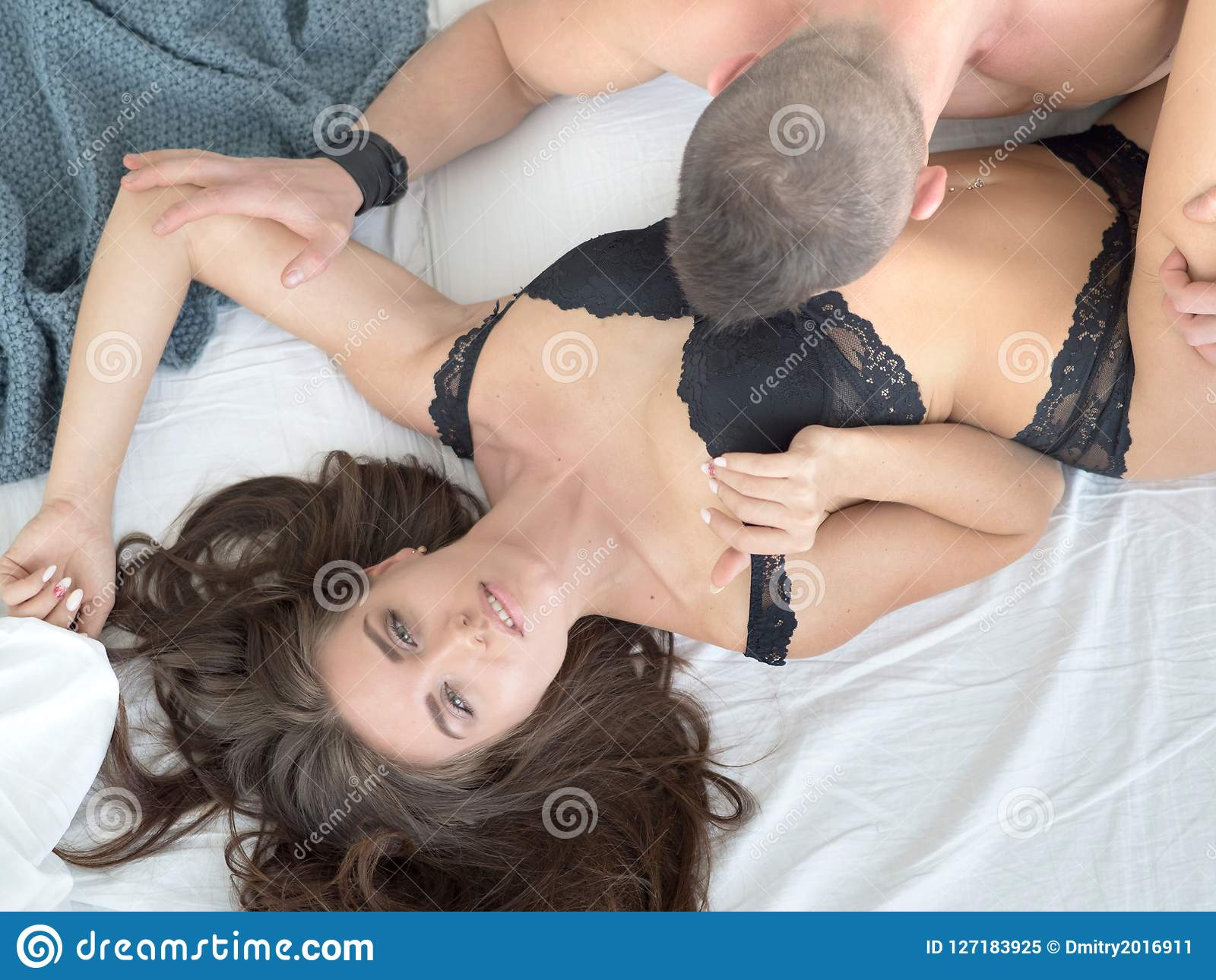 Young Passionate Couple Making Love In Bed. Stock Image