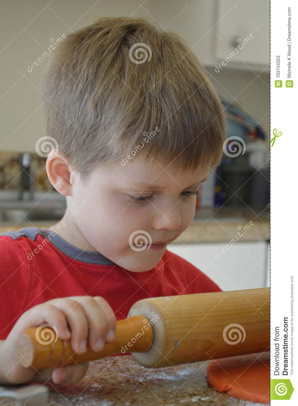 Young pastry chef making cookies