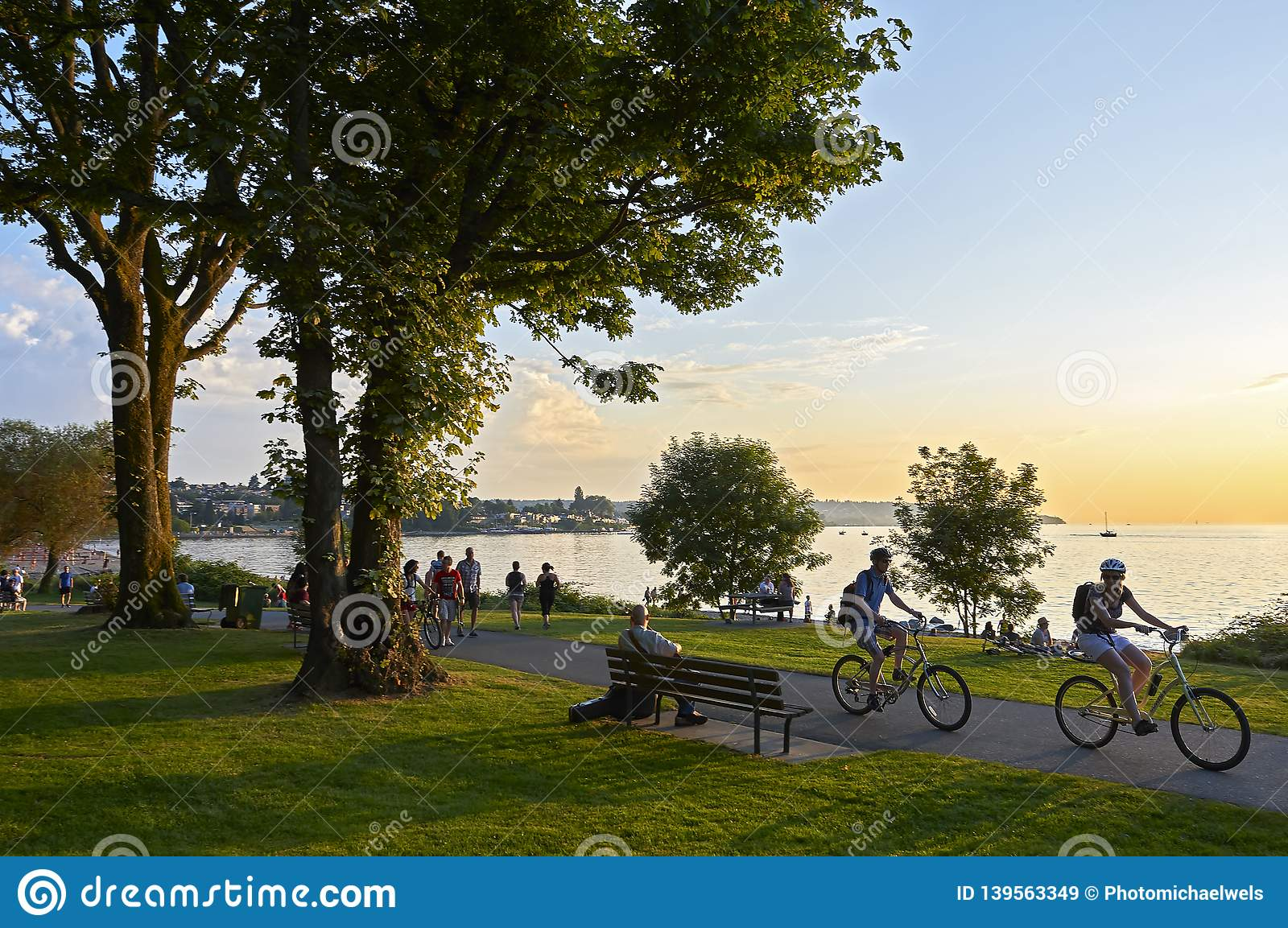 Young people biking and walking at Stanley Park late afternoon