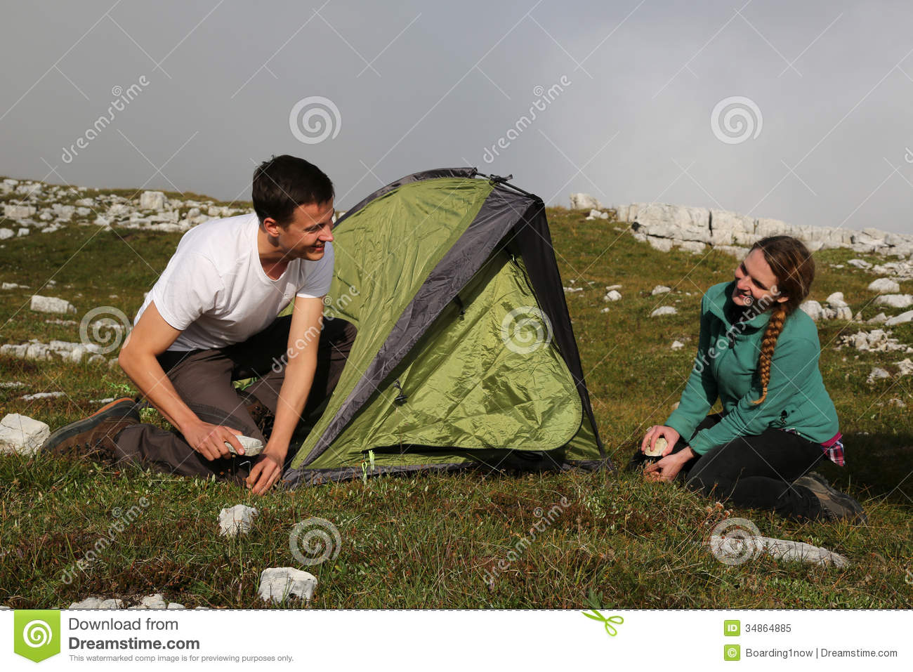 Young people building up a tent in the mountains Royalty Free Stock Photo & The tent building stock image. Image of exterior city - 1397747
