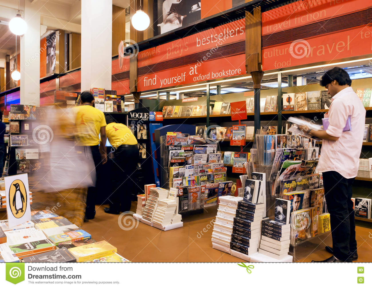 Young People Choose The Magazines And Books Inside The Popular