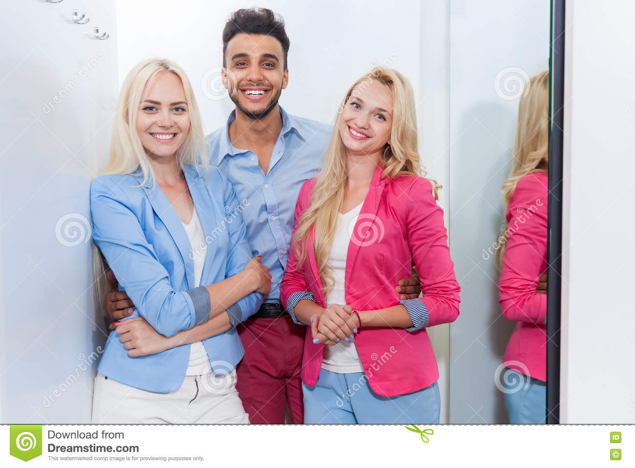 Young People Fashion Shop Fitting Room Shopping Happy Smiling Woman And Man Trying New Clothes