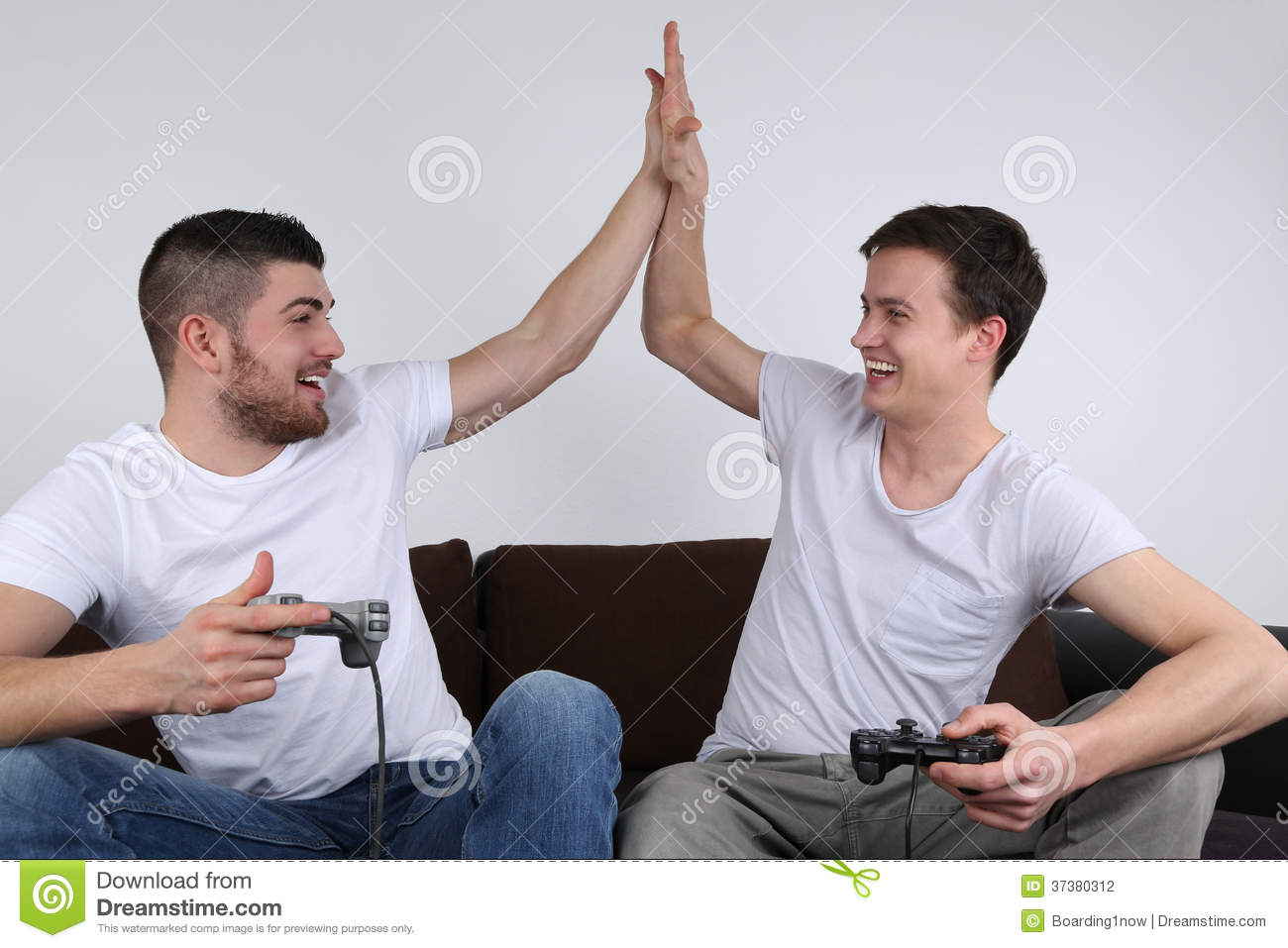 Young People Giving High Five While Playing Video Games ...