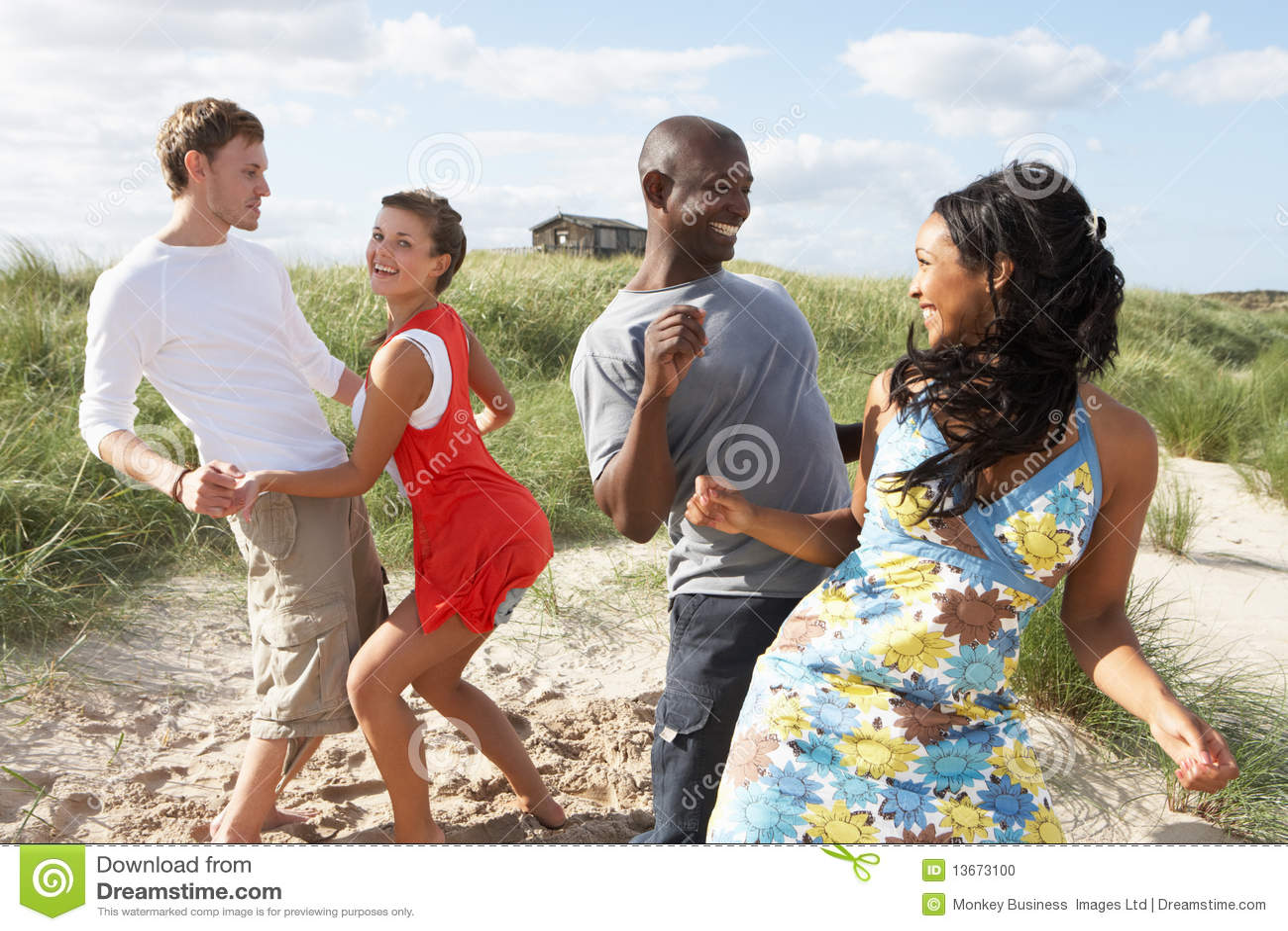 man and woman couple having fun dancing on a beach stock photo