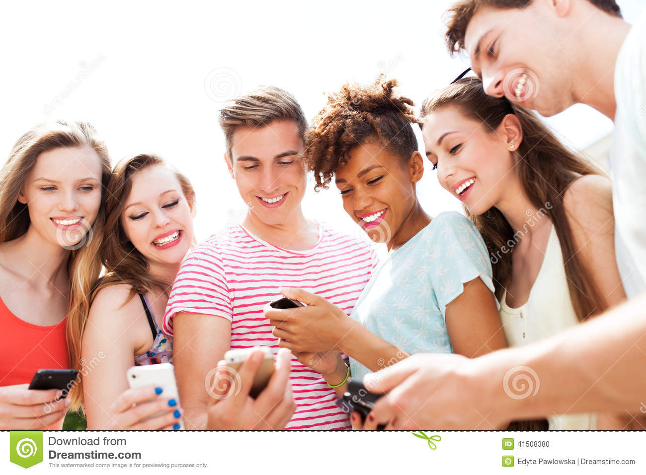 Young People Looking At Smartphones Stock Photo Image