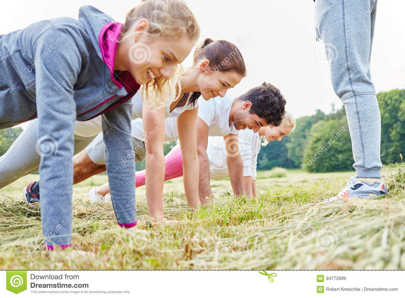 Young people making push ups