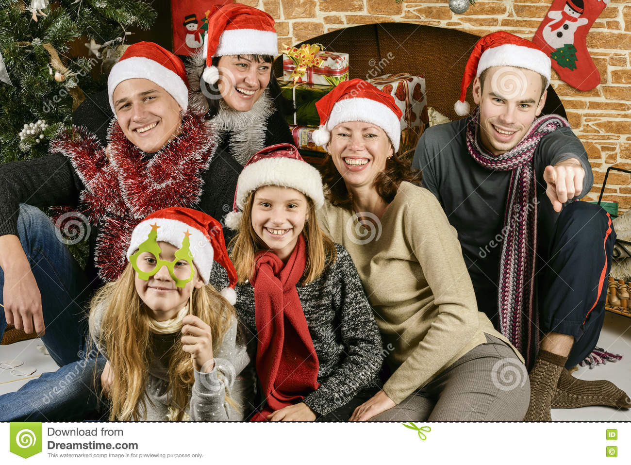Young people near the Christmas tree