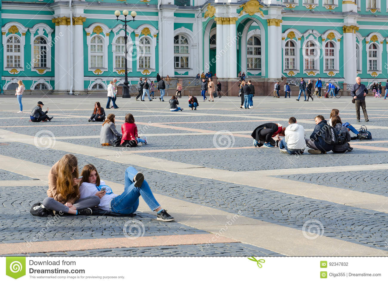 Young people rest on Palace Square, St. Petersburg, Russia