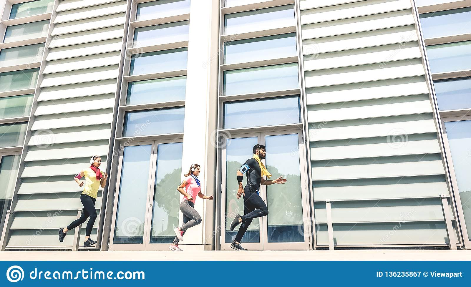 Young People Running In Modern Urban Area - Fitness Girls ...