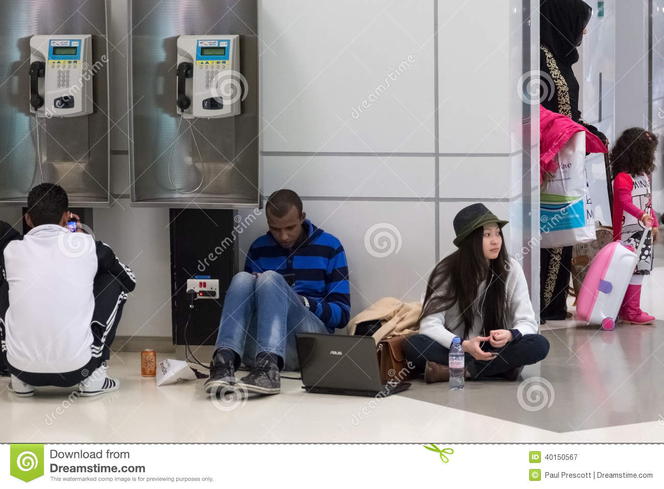 Young people sitting on the floor and waiting for their for Floor someone