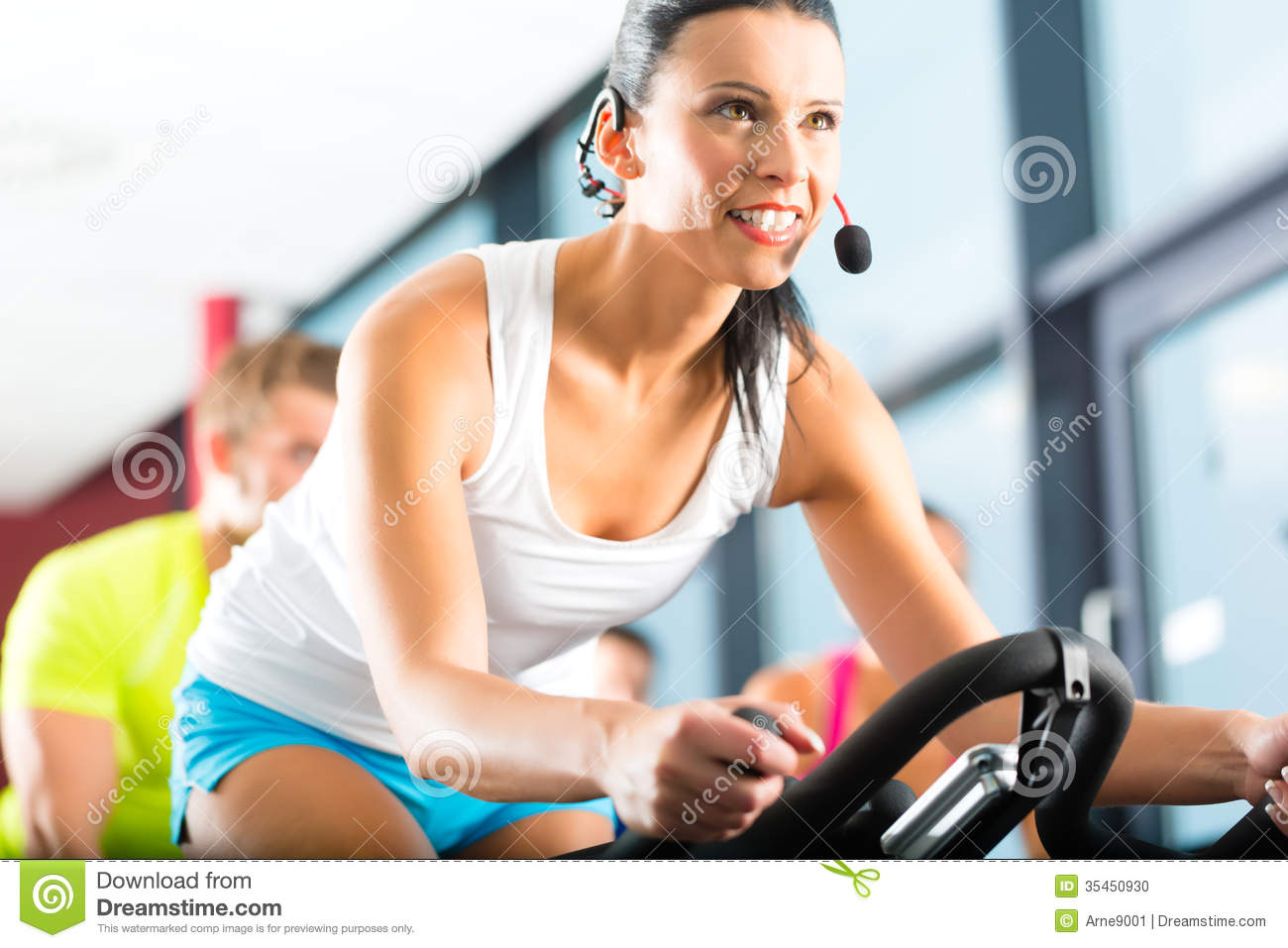 Young people spinning in the fitness gym stock photo for Gimnasio sport gym