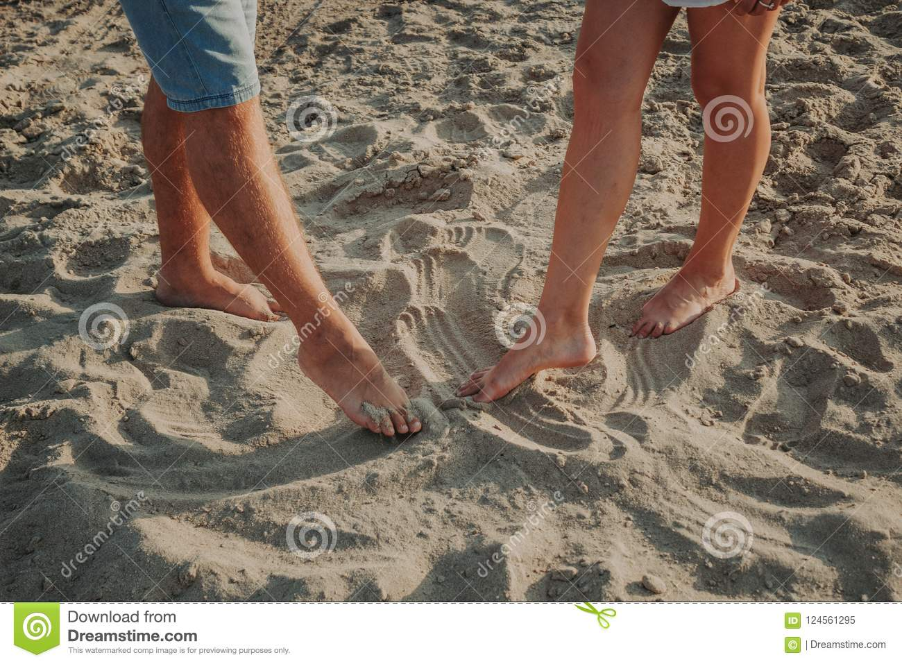 Two pairs of legs draw on the sand figures