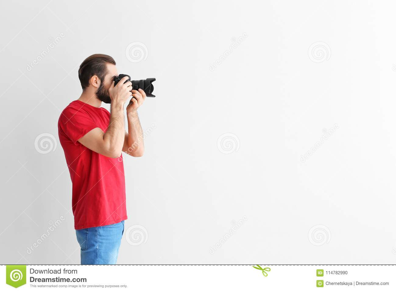 Young photographer with professional camera