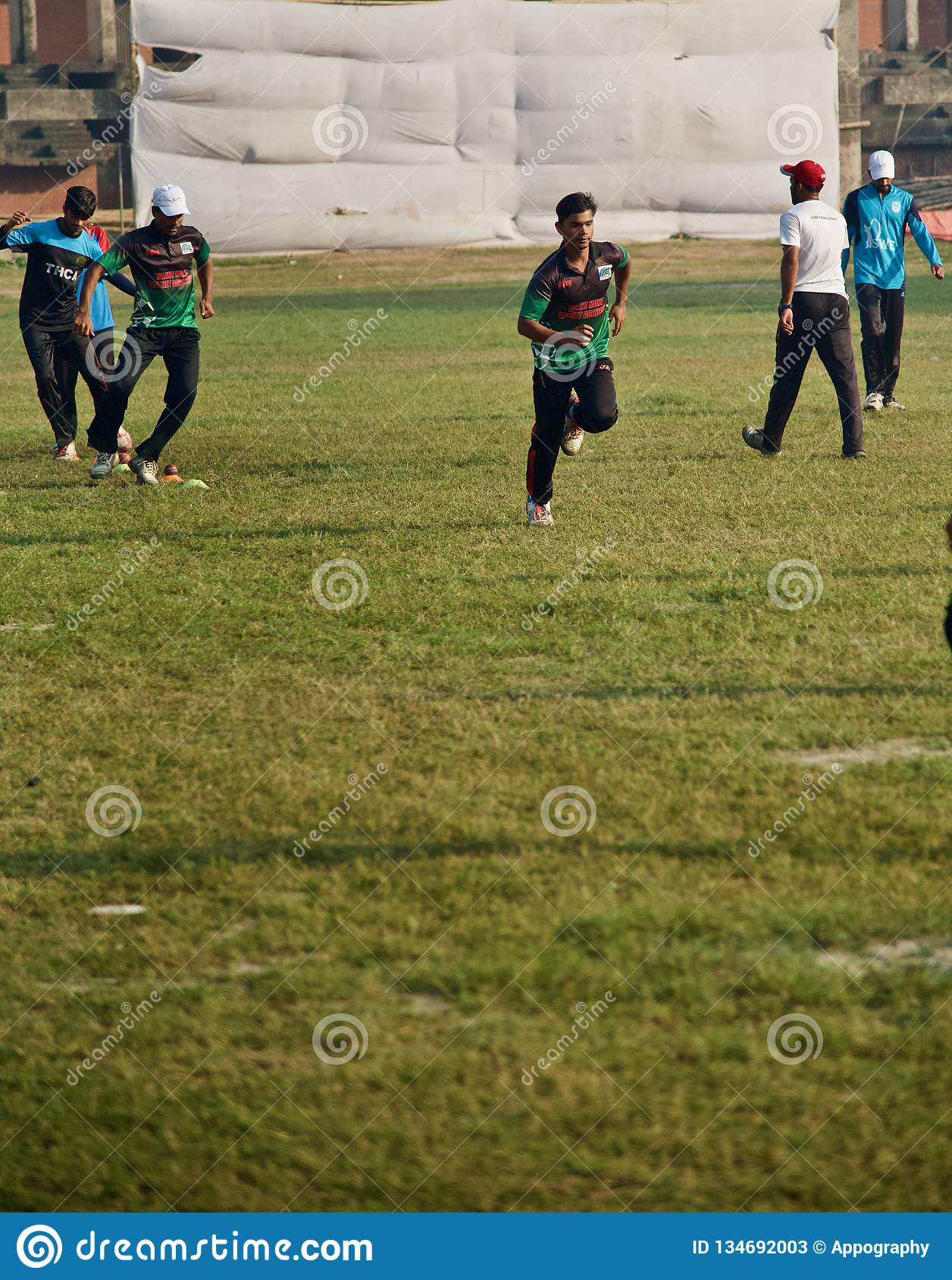 Young boys running in a field
