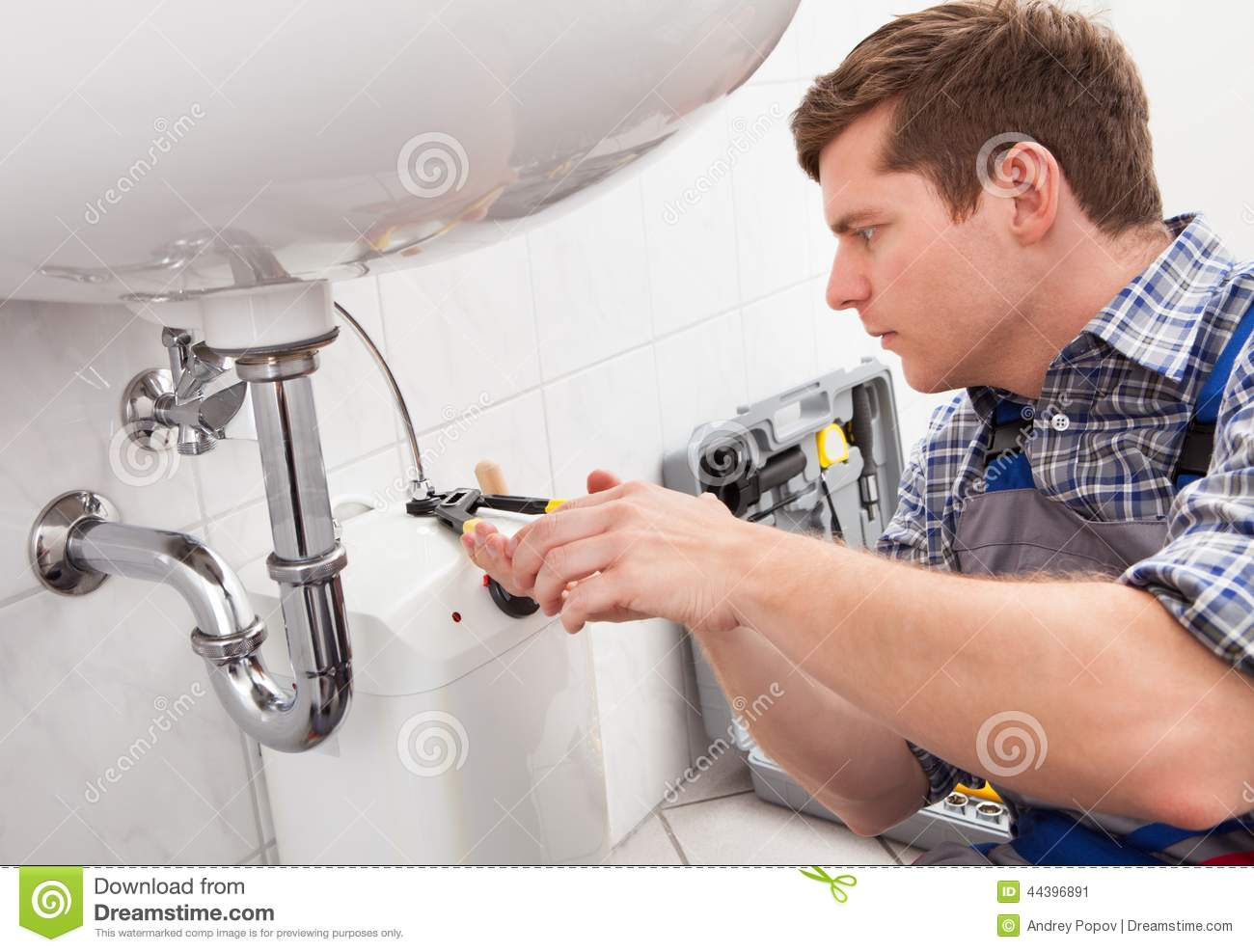 fixing a bathroom sink plumber fixing a sink in bathroom stock image 18307