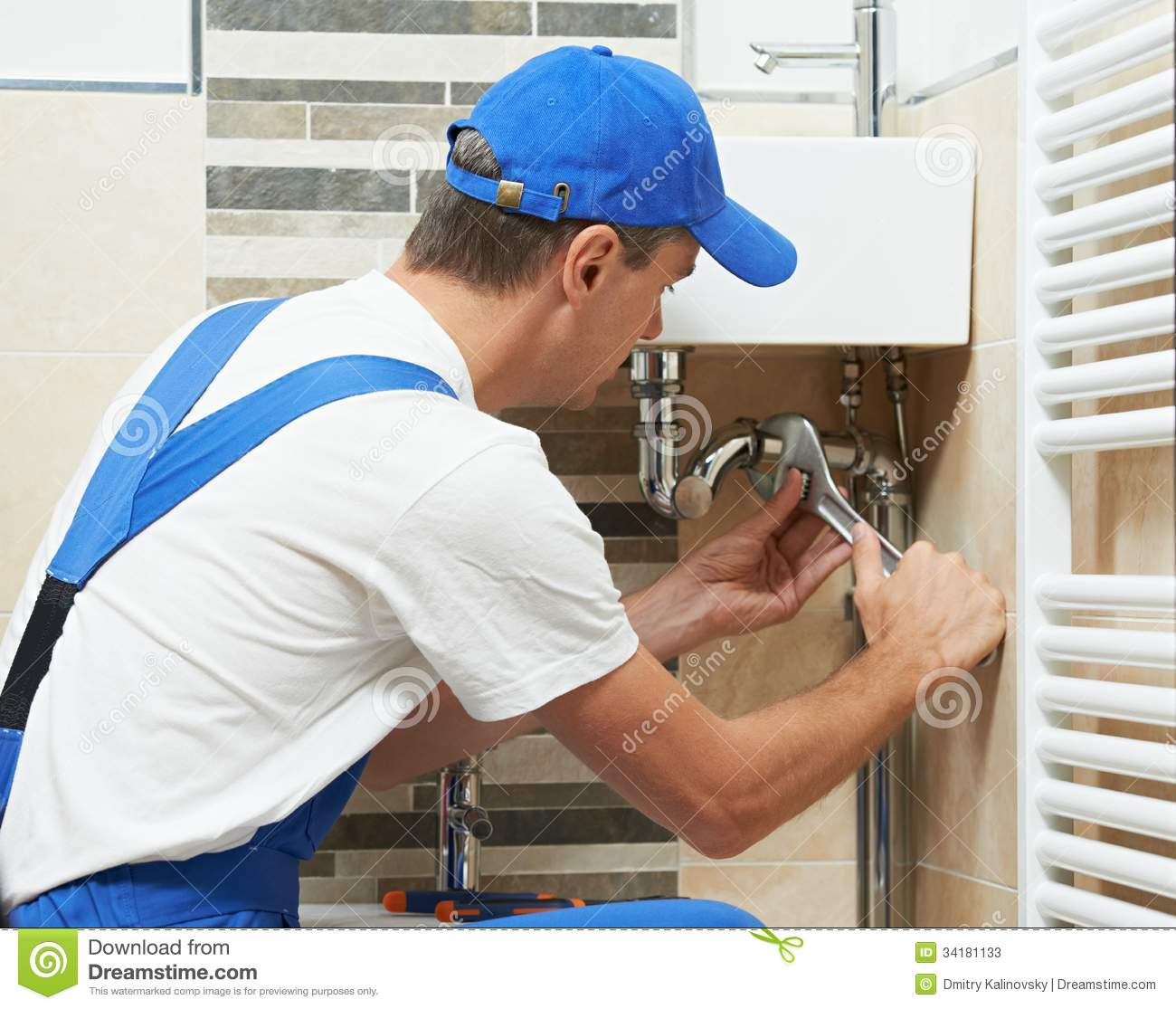 Young plumber man worker stock image. Image of installing - 34181133