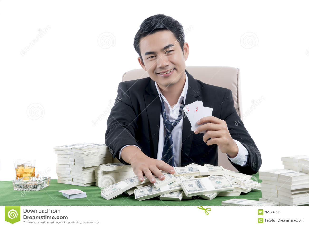 The young poker player winning and holding set of aces