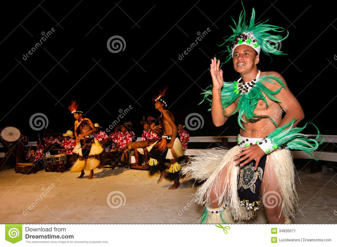 Polynesian Pacific Island Tahitian male dancers in colorful costume ...