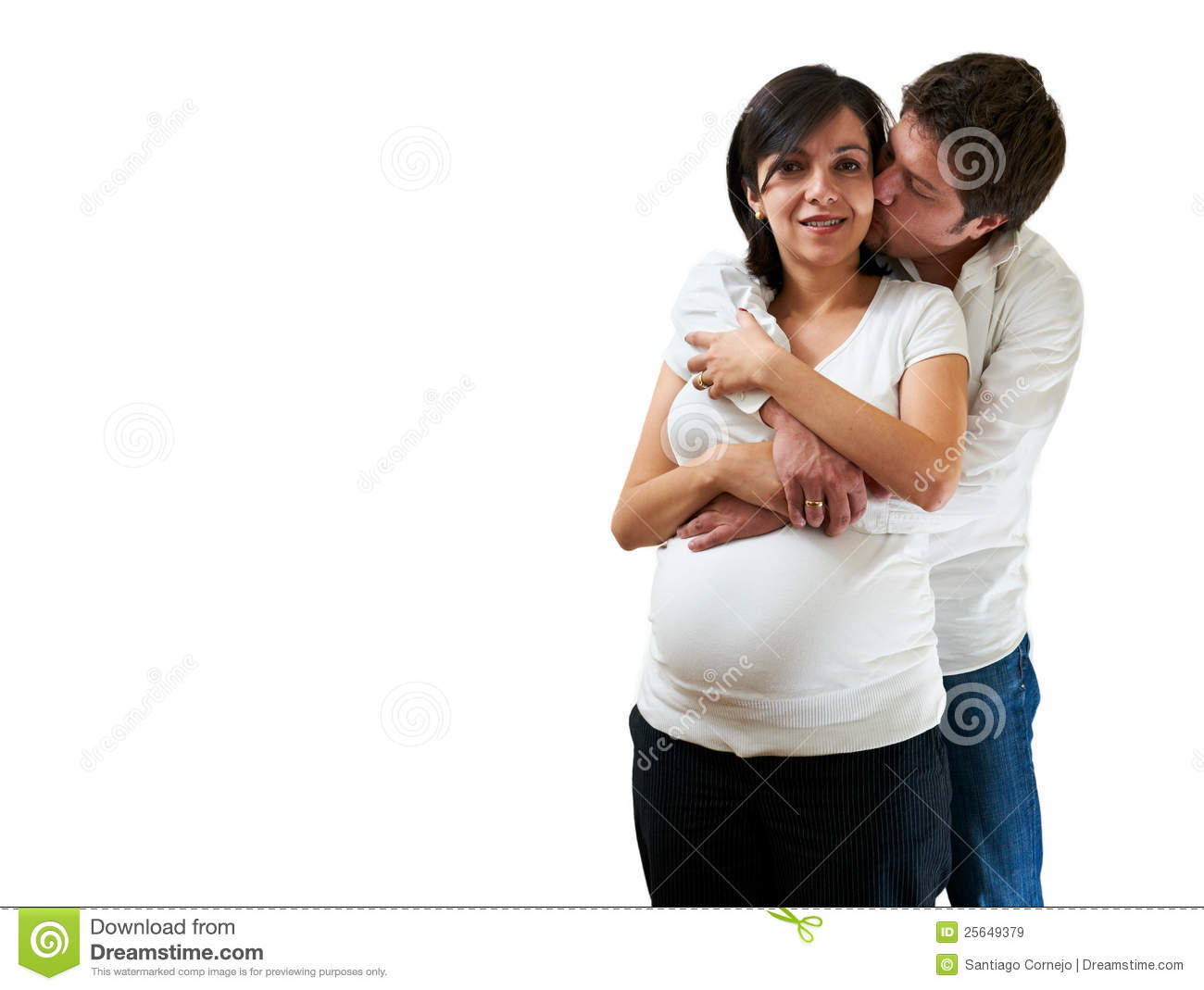Young pregnant couple hugging on white background. Young Pregnant Couple Hugging On White Background Royalty Free