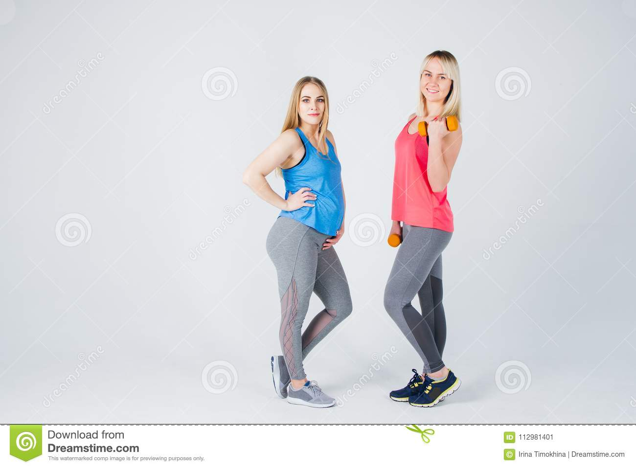 Pregnant girl and her friend are engaged in fitness