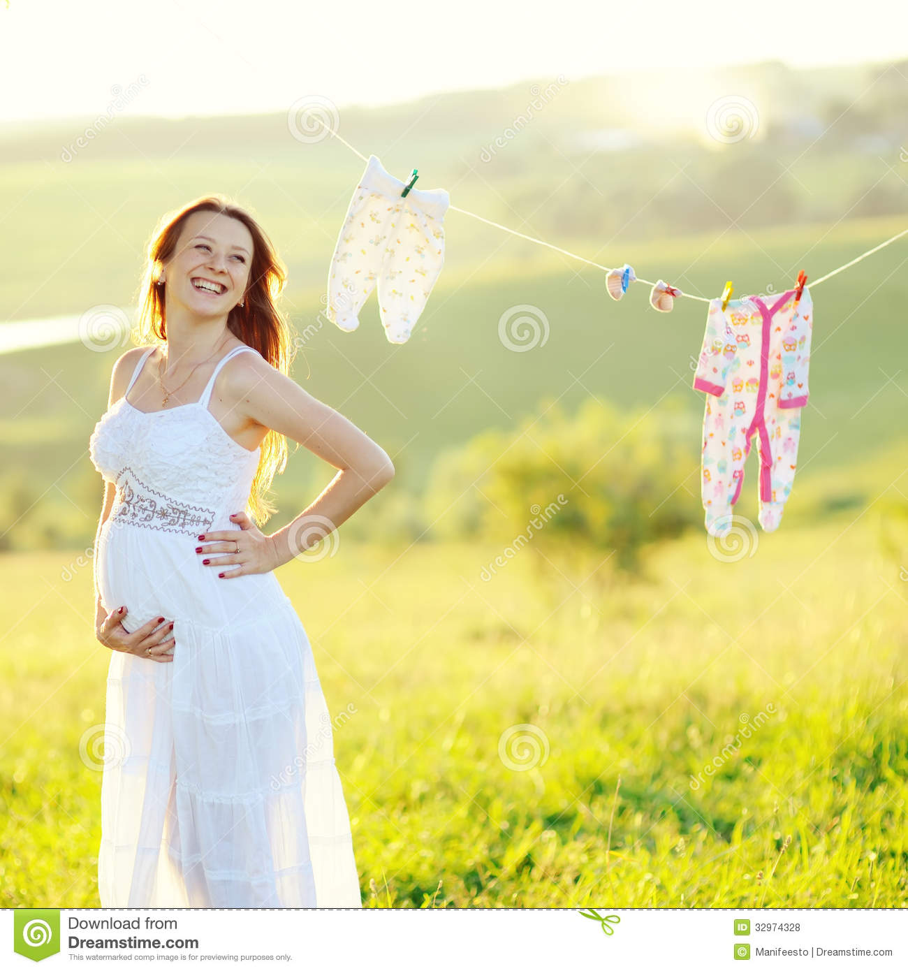 Young pregnant woman in decorated garden royalty free for Gardening while pregnant