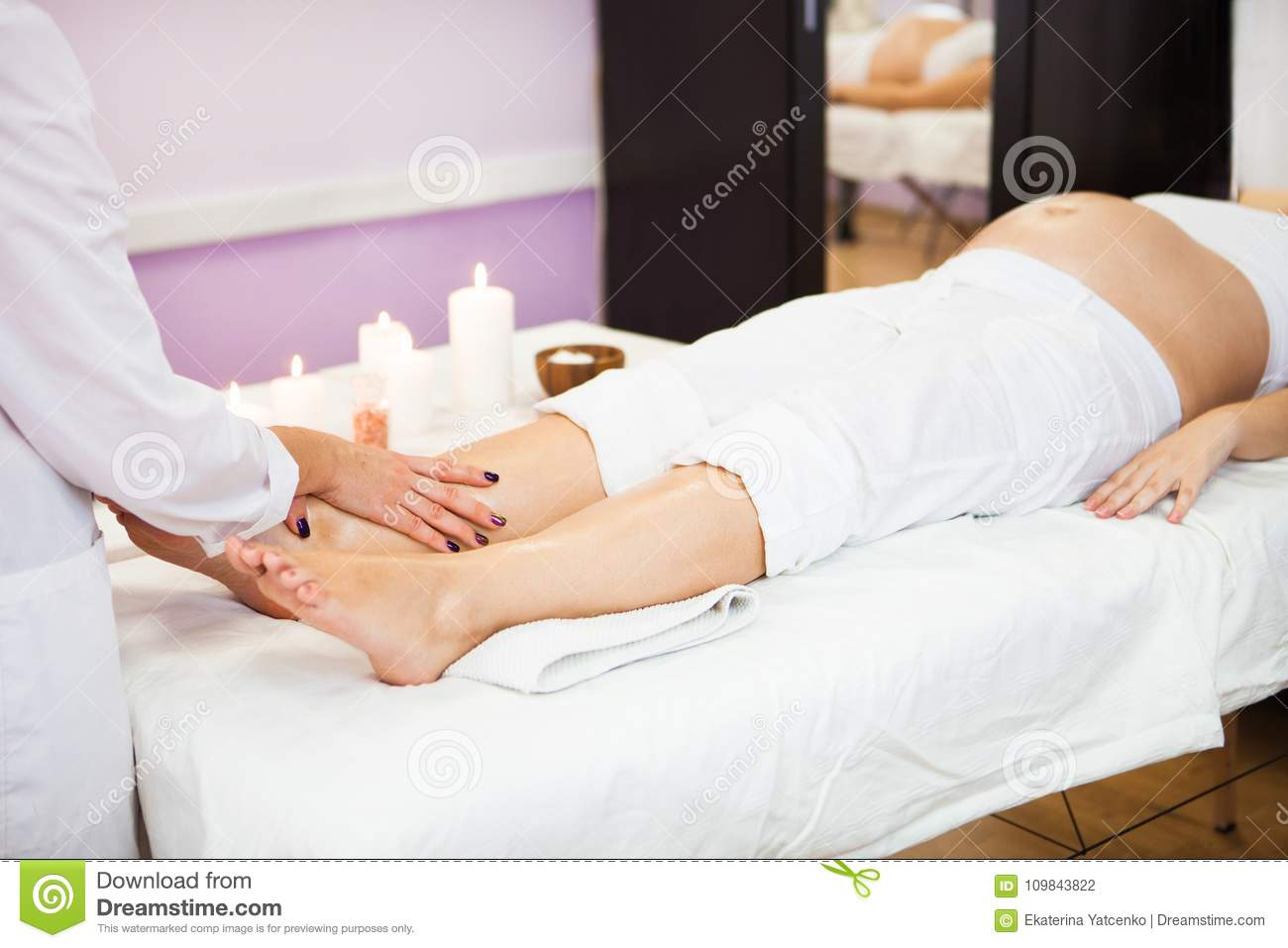 Young Pregnant Woman Relaxing With Hand Leg Massage At ...