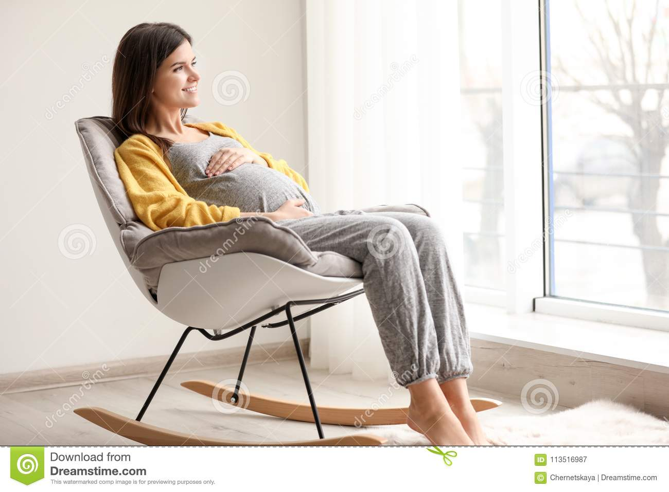 Fine Young Pregnant Woman Resting In Rocking Chair Stock Image Creativecarmelina Interior Chair Design Creativecarmelinacom