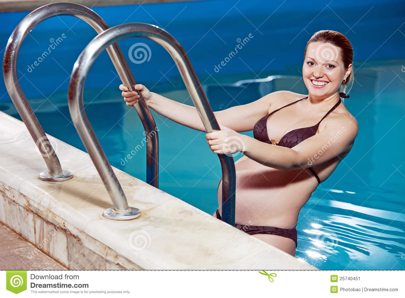 Young pregnant woman in a swimming pool