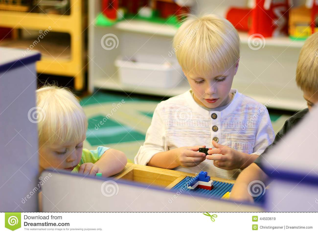 young preschool children playing building blocks in school class stock image image of working. Black Bedroom Furniture Sets. Home Design Ideas