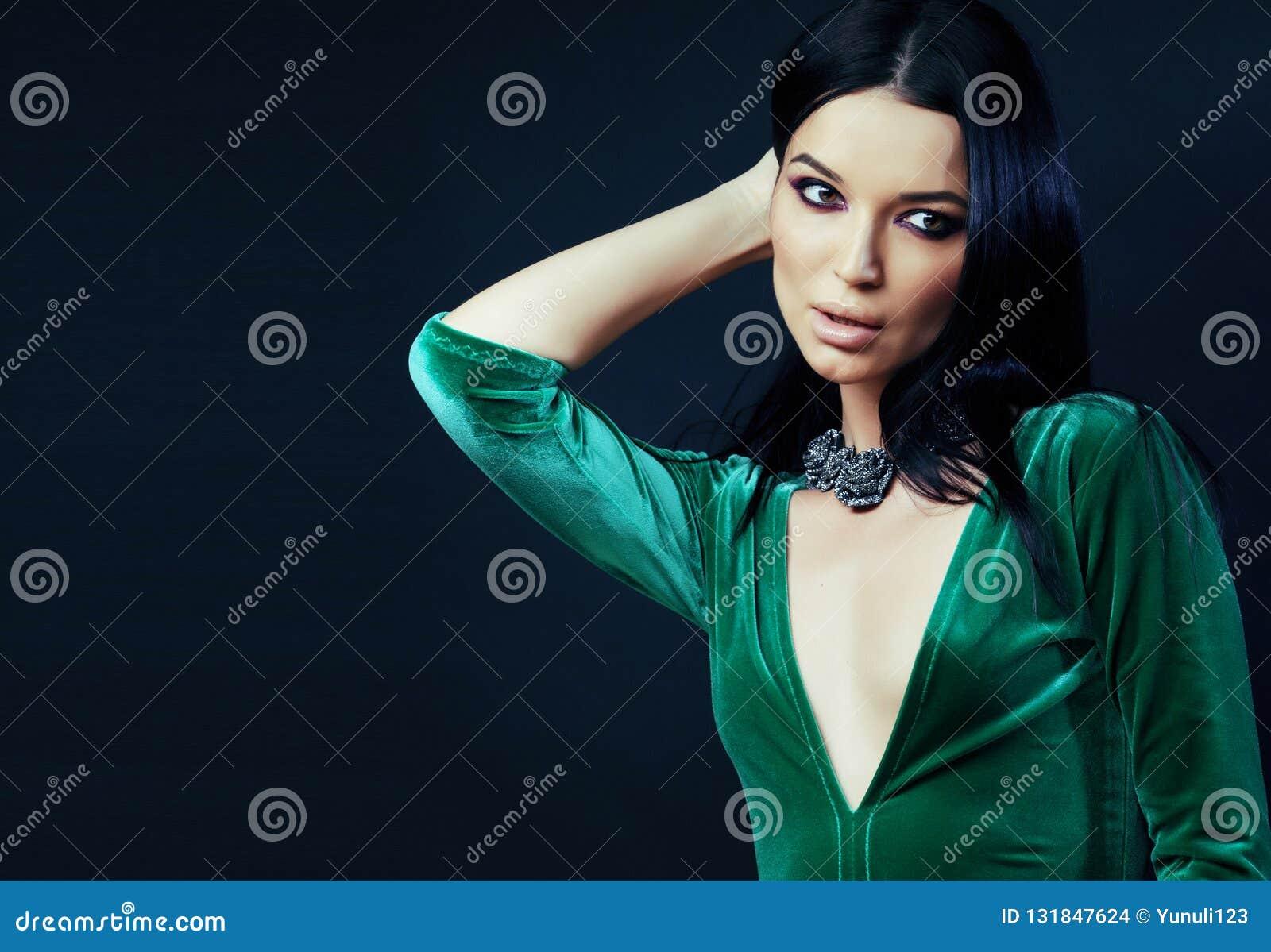 young pretty brunette woman fashion dressed, bright makeup, eleg