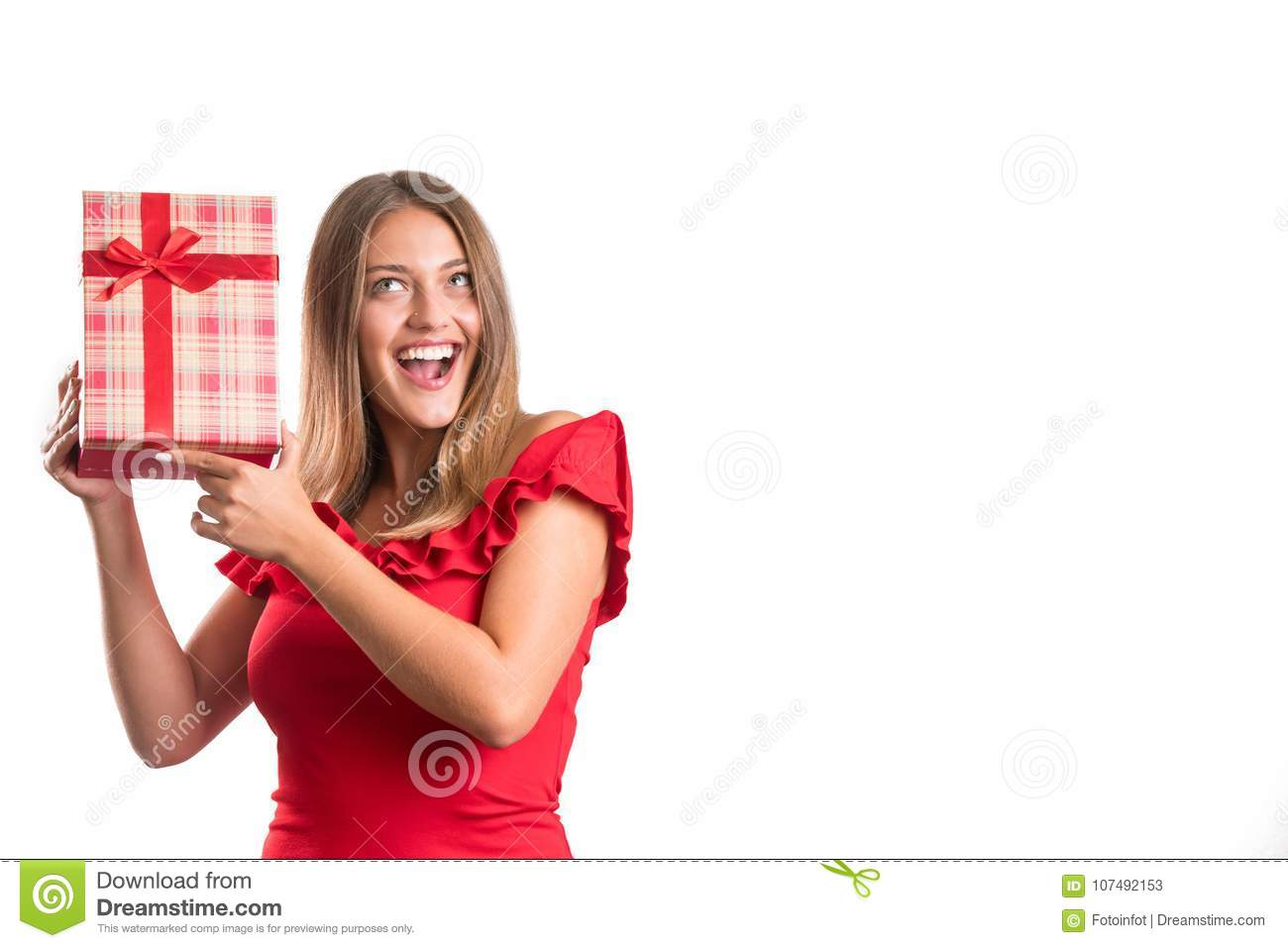 Young pretty girl in red dress holding presents. isolated