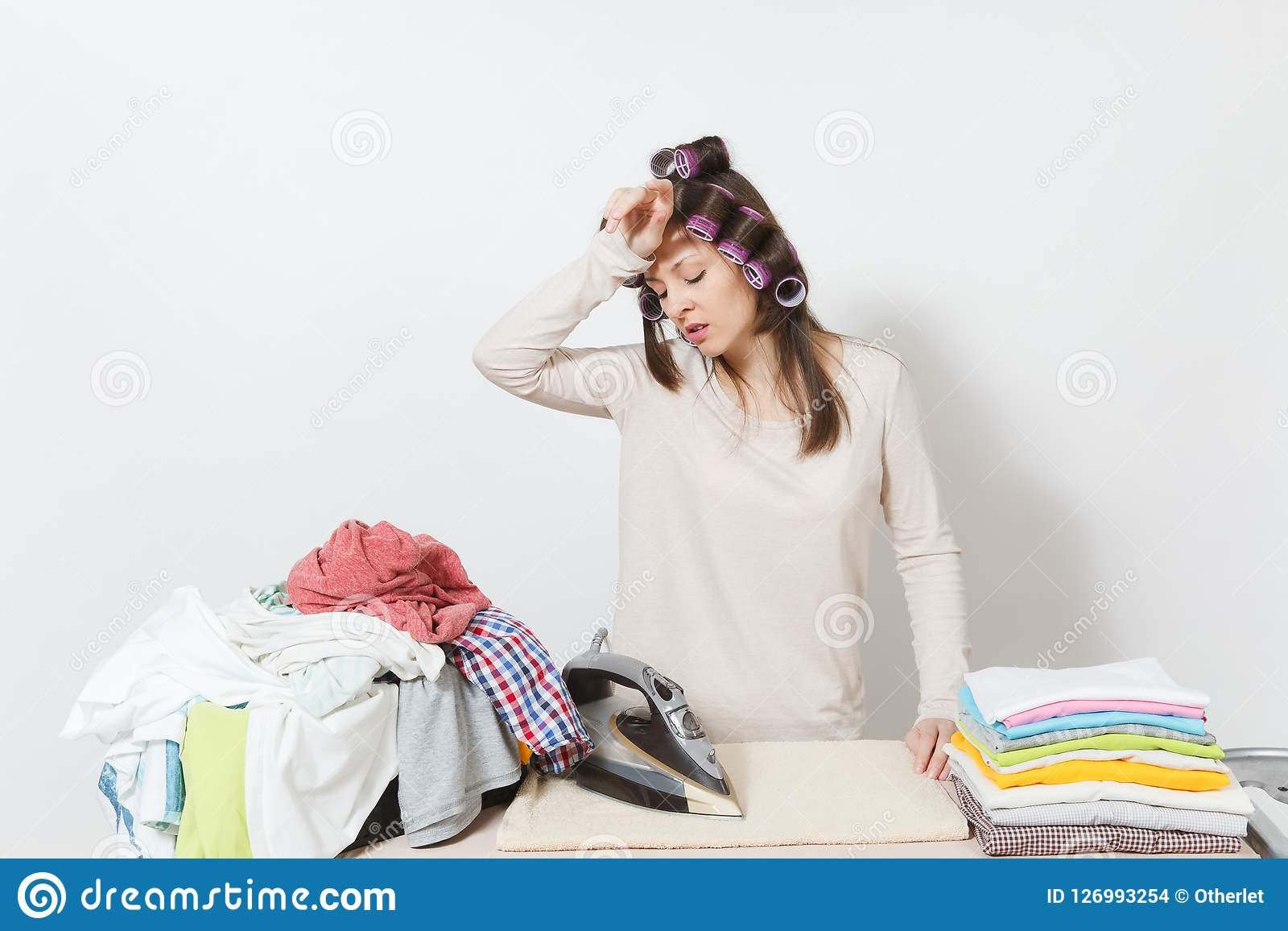 Young pretty housewife. Woman on white background. Housekeeping concept. Copy space for advertisement.