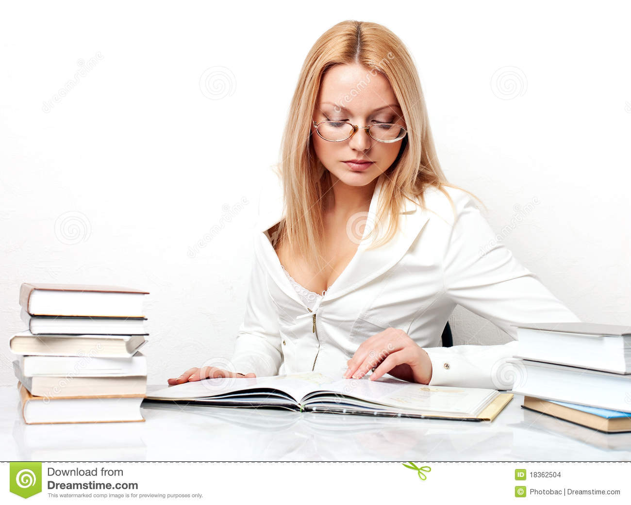 Young Pretty Woman Learning At Table With Books Stock