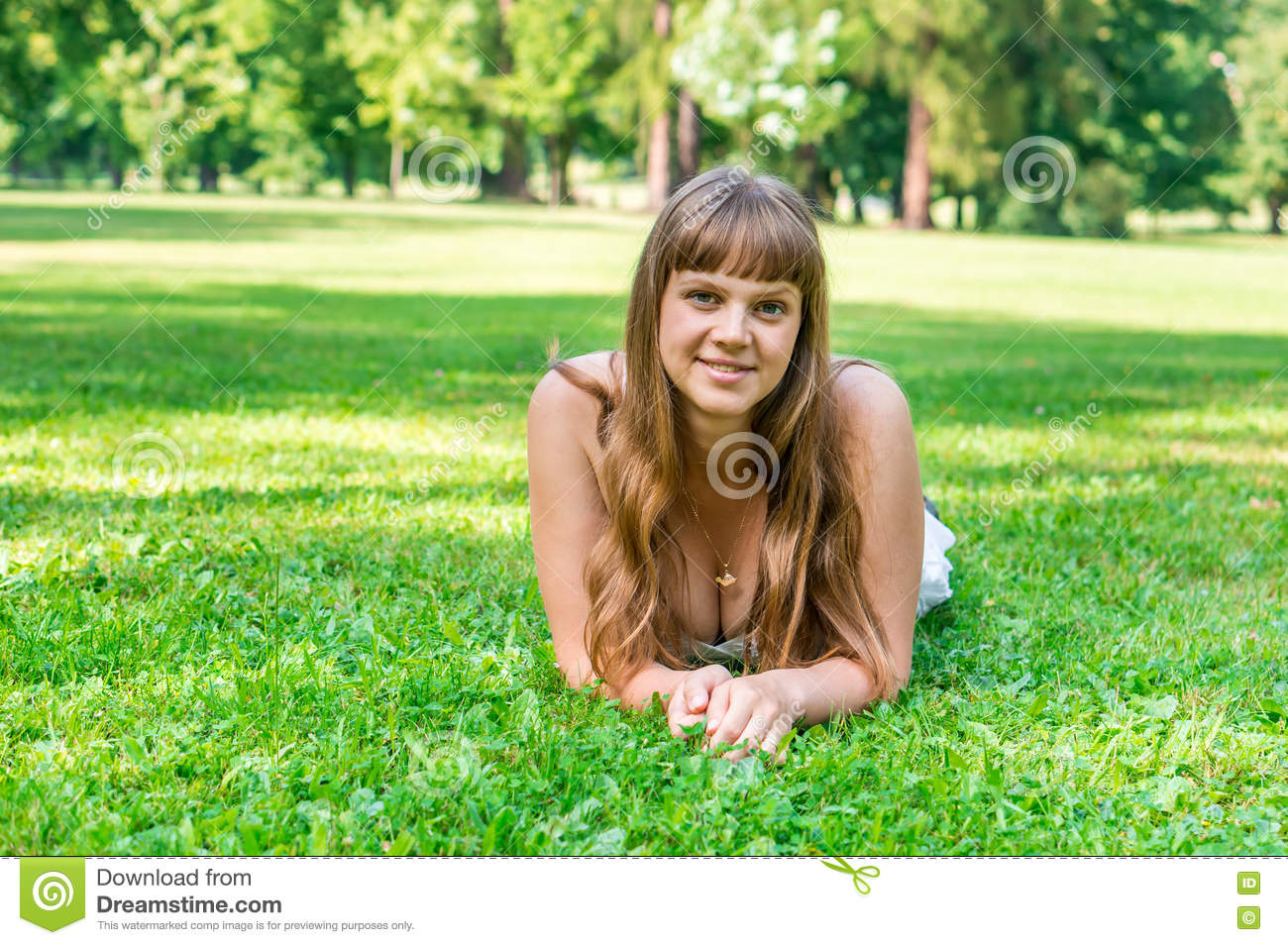 Young pretty woman lying on green grass in park royalty for Pretty grass