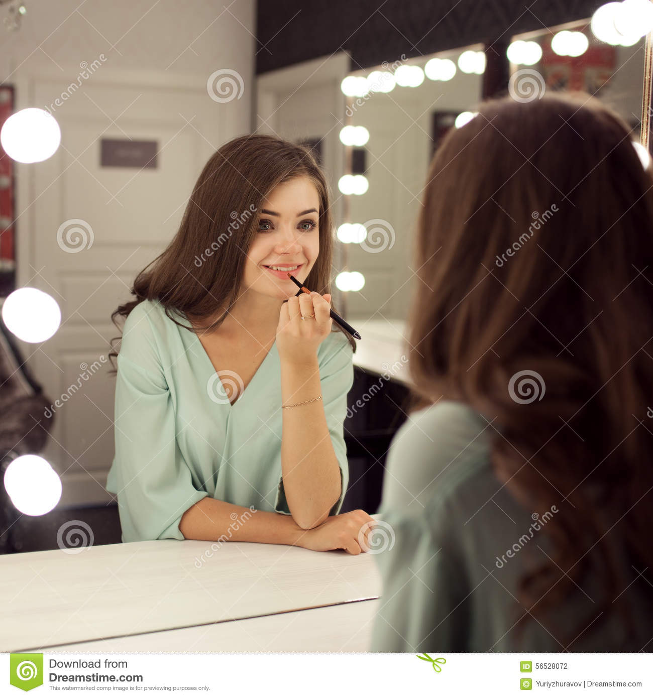 Young Pretty Woman With Make Up And Reflection In Dressing