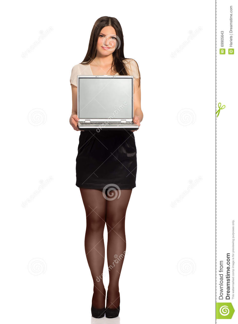 Young pretty woman presenting laptop screen