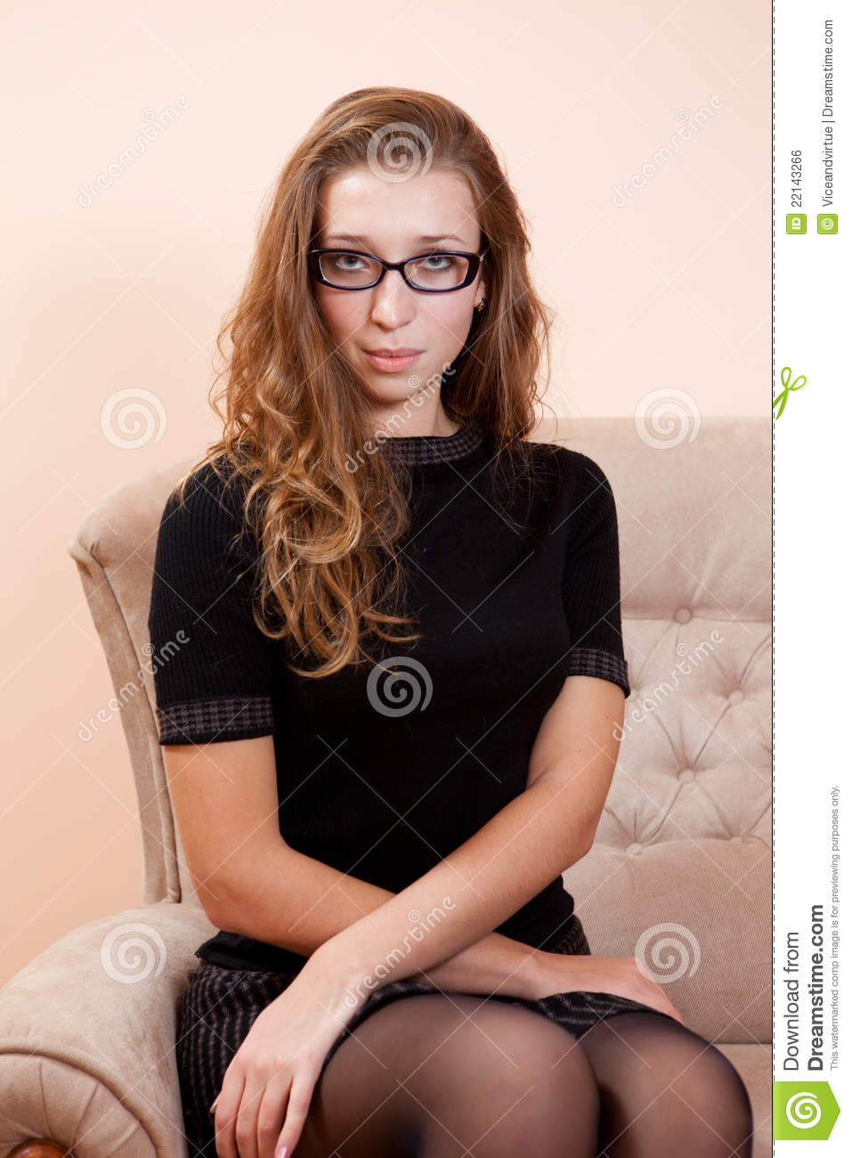 young pretty woman sitting in chair stock photo