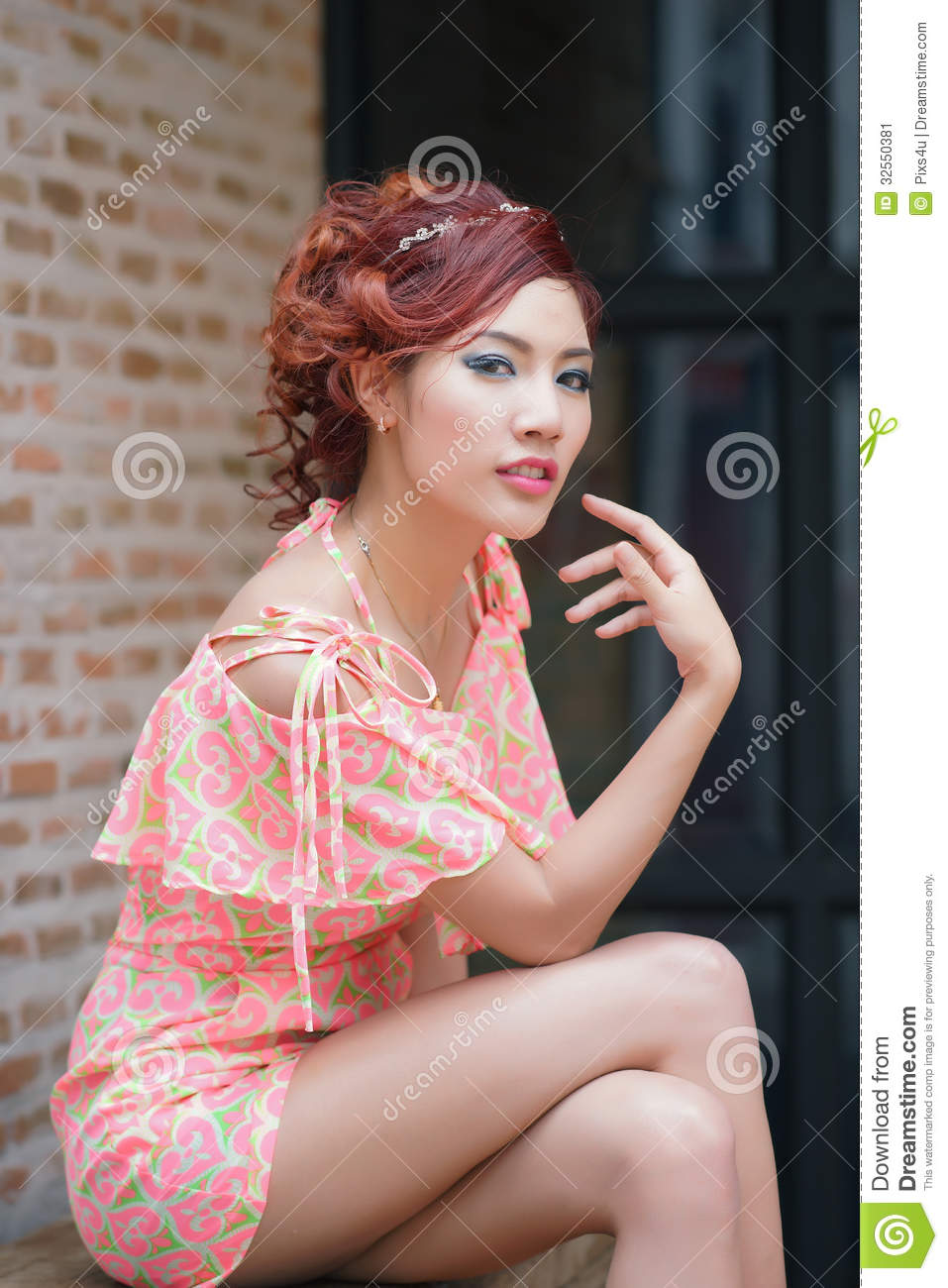 Young Pretty Woman Sitting On Wooden Bench Stock Image