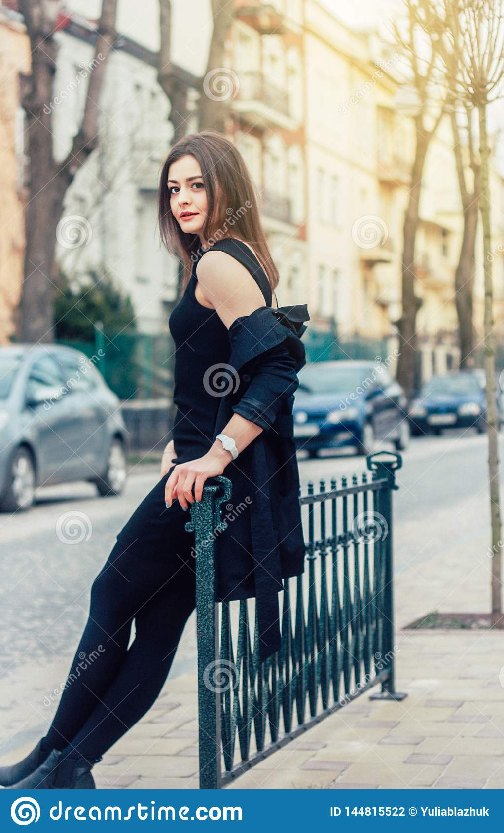 Young pretty woman at the street. Classic clothes style, natural look