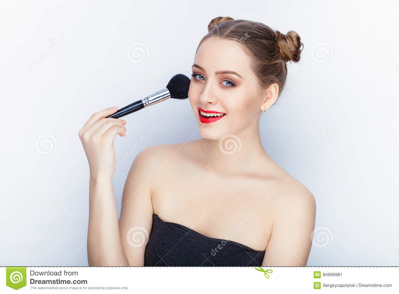 Young Pretty Woman Trendy Makeup Bright Red Lips Bun Hairstyle Bare