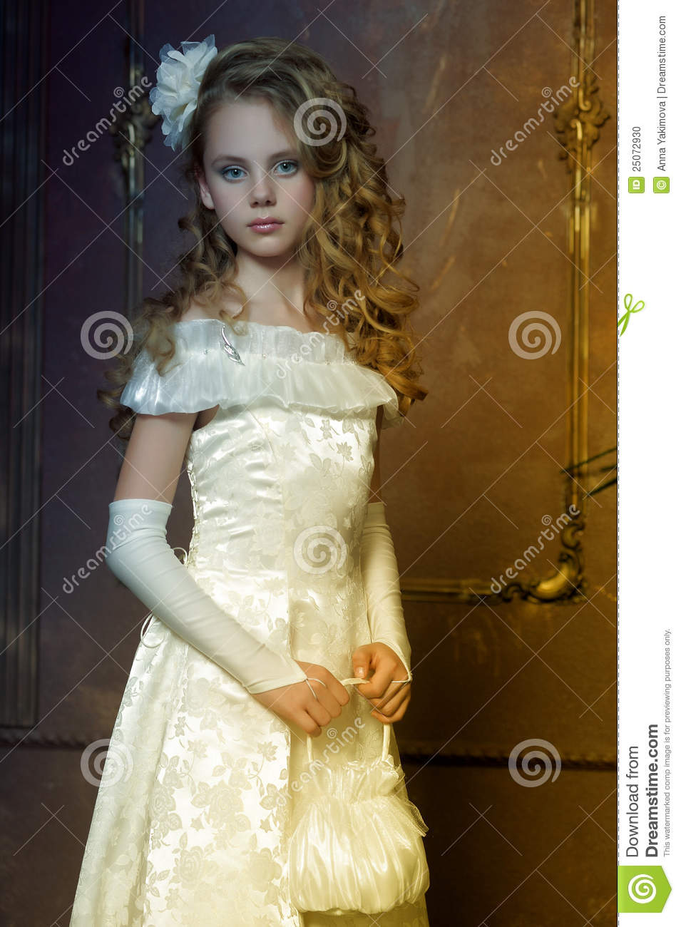 young princess in a white dress stock photo