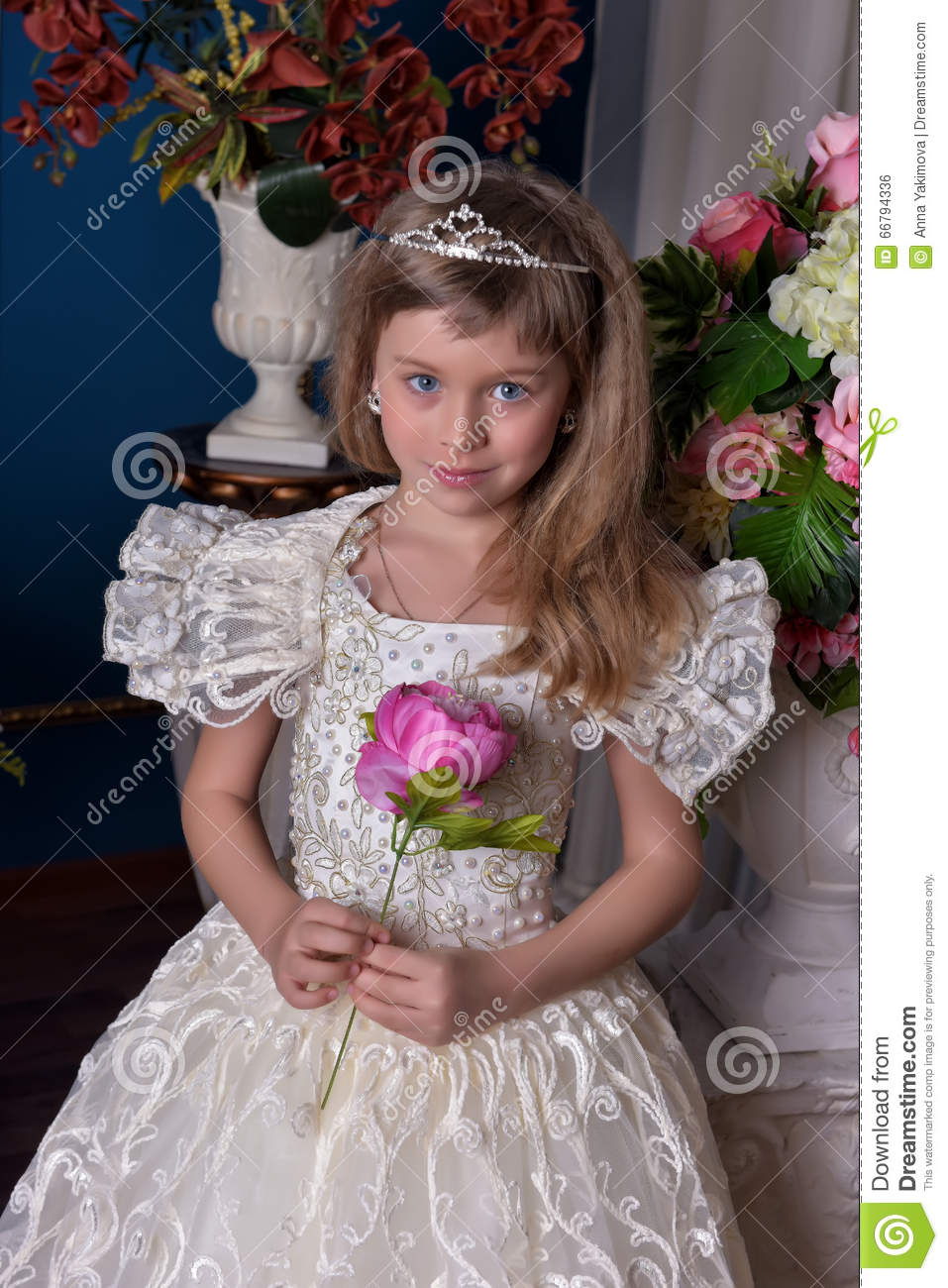 Young Princess In A White Dress With A Tiara On Her Head Stock Photo