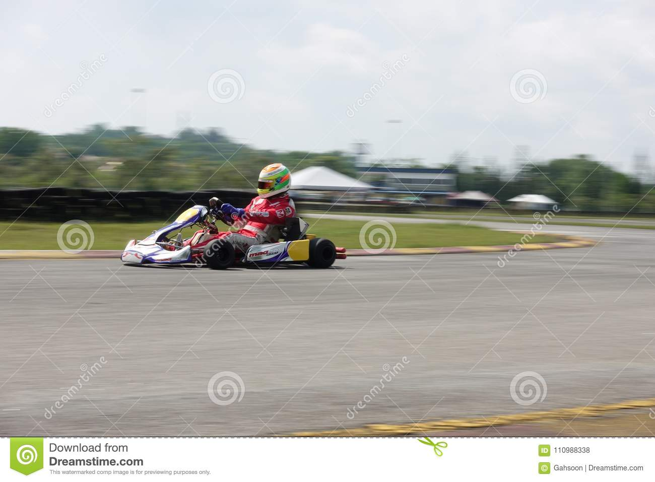Young Professional Racer With Competing With His Go-kart In