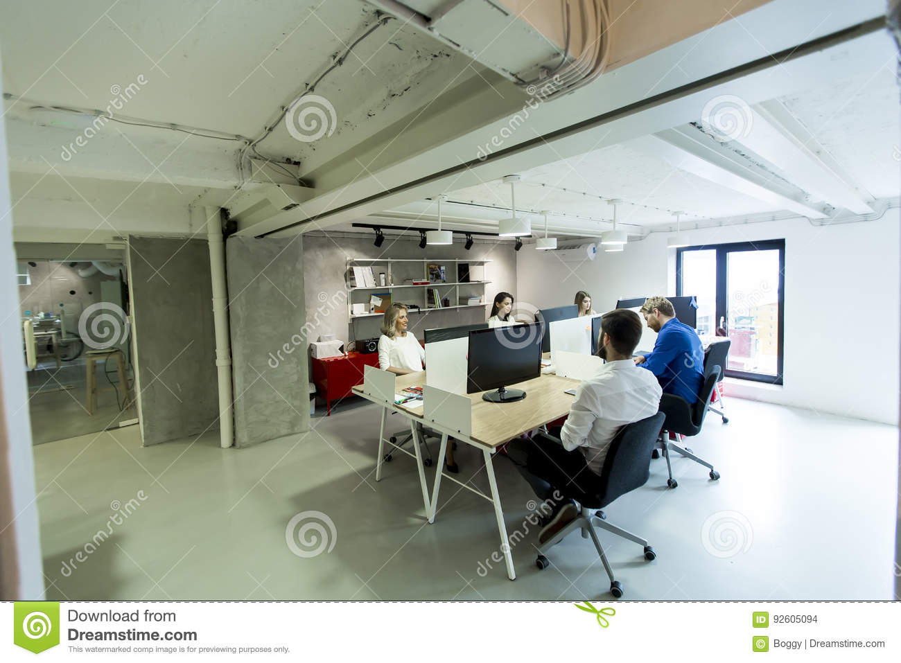 Young Programmers Sit And Work In Modern Office Stock