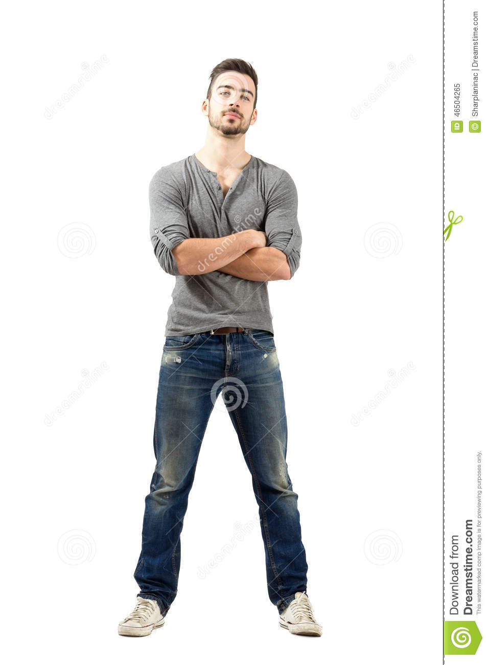 Young proud man with crossed arms looking at camera