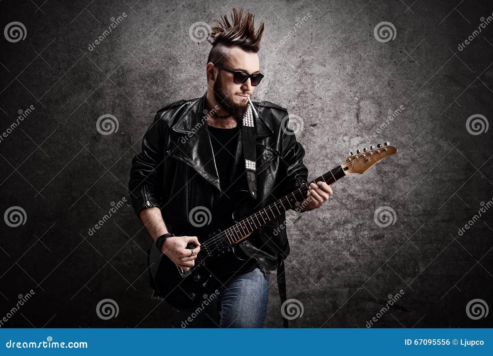Young Punk Rocker Playing Electric Guitar Stock Photo