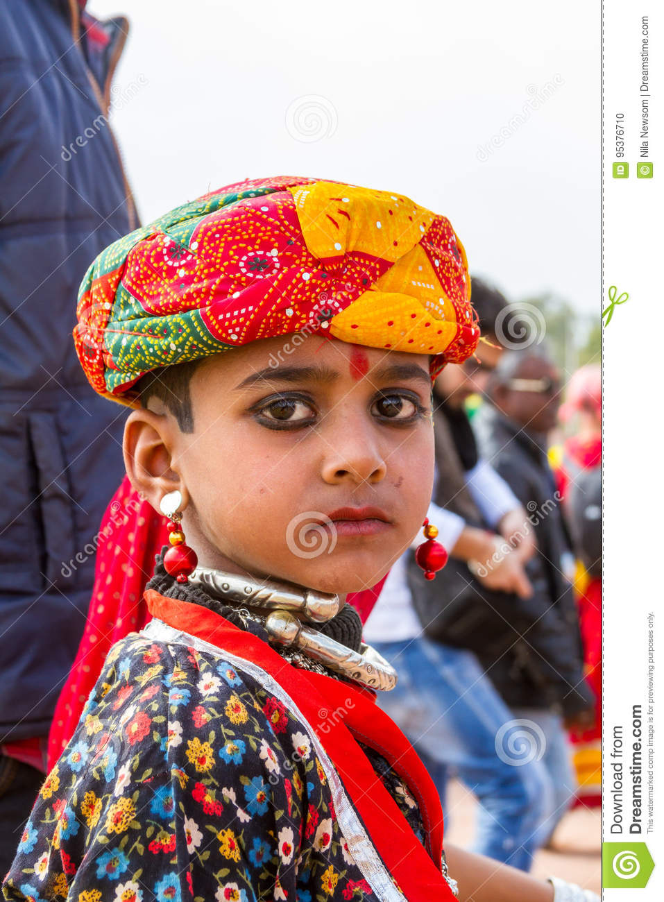 86c125348 Bikaner, India, 14th January 2017 - A young Rajasthani boy dressed in traditional  attire at the Bikaner Camel Mela in Rajastan, India.