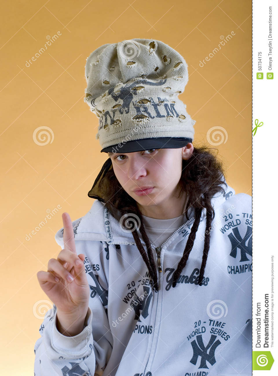 Young Rapper In A Funny Hat Showing Thumbs